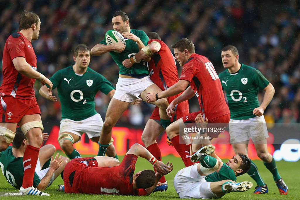 Dave Kearney of Ireland is challenged by Alex Cuthbert of Wales during the RBS Six Nations match between Ireland and Wales at the Aviva Stadium on...