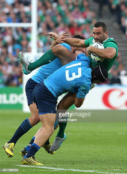 Dave Kearney of Ireland is tackled by Italian defense during the 2015 Rugby World Cup Pool D match between Ireland and Italy at the Olympic Stadium...
