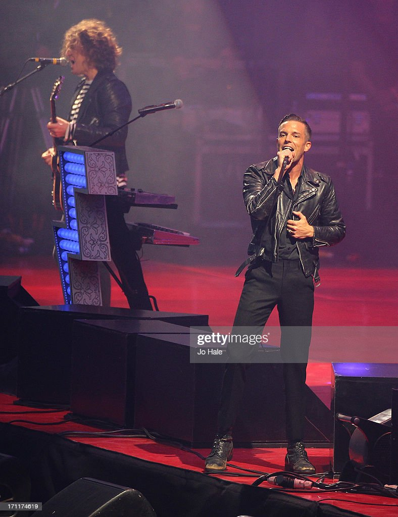 Dave Keuning and Brandon Flowers of The Killers perform on stage at Wembley Stadium on June 22, 2013 in London, England.