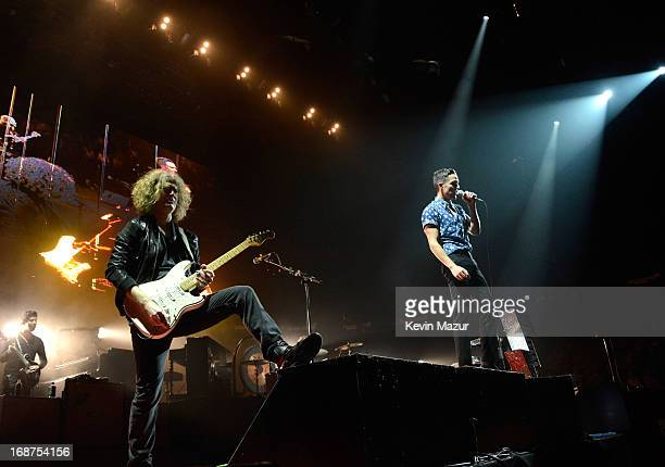 Dave Keuning and Brandon Flowers perform during the Killers 'Battle Born' tour at Madison Square Garden on May 14 2013 in New York City