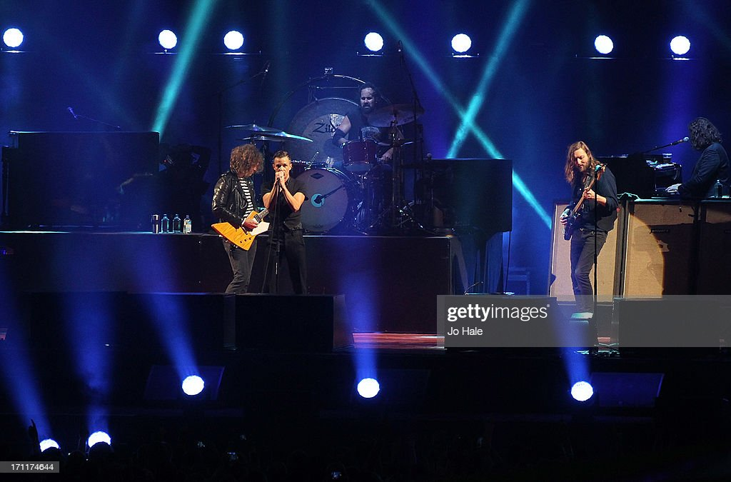 Dave Keuning, Brandon Flowers, and <a gi-track='captionPersonalityLinkClicked' href=/galleries/search?phrase=Mark+Stoermer&family=editorial&specificpeople=234409 ng-click='$event.stopPropagation()'>Mark Stoermer</a> of The Killers perform on stage at Wembley Stadium on June 22, 2013 in London, England.