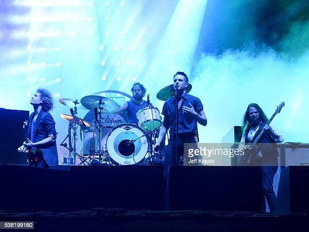 Dave Keuning Brandon Flowers and Ronnie Vannucci Jr of The Killers perform onstage during 2016 Governors Ball Music Festival at Randall's Island on...