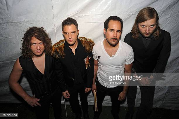 Dave Keuning Brandon Flowers Ronnie Vannucci Jr and Mark Stoermer of The Killers pose backstage before performing during the 2009 Lollapalooza music...