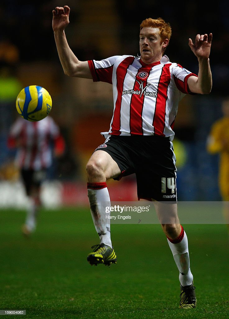 <a gi-track='captionPersonalityLinkClicked' href=/galleries/search?phrase=Dave+Kitson&family=editorial&specificpeople=227434 ng-click='$event.stopPropagation()'>Dave Kitson</a> of Sheffield United controls the ball during the FA Cup Third Round match between Oxford United and Sheffield United at the Kassam Stadium on January 5, 2013 in Oxford, England.