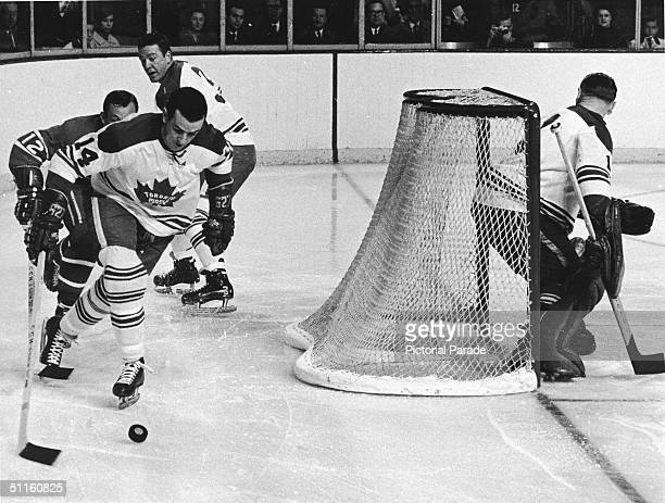 Dave Koen of the Toronto Maple Leafs chases the puck from behind his team's goal during game two of the 1967 Stanley Cup finals Montreal Quebec...