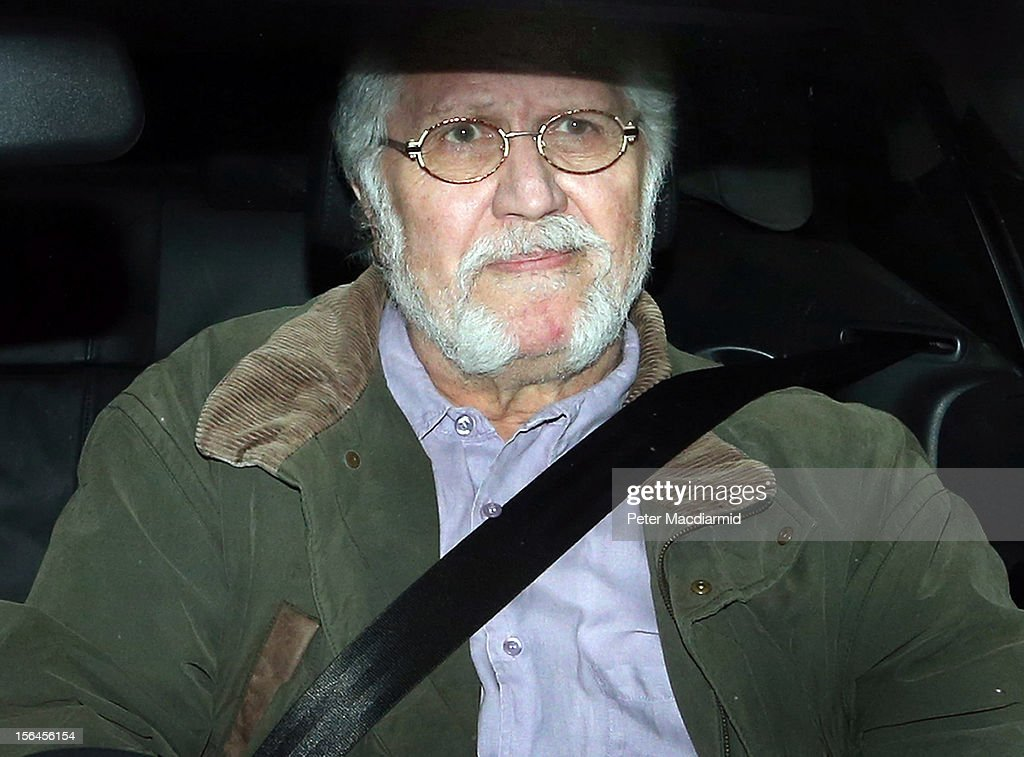 <a gi-track='captionPersonalityLinkClicked' href=/galleries/search?phrase=Dave+Lee+Travis&family=editorial&specificpeople=1624287 ng-click='$event.stopPropagation()'>Dave Lee Travis</a> arrives home after leaving Aylesbury police station on November 15, 2012 near Leighton Buzzard, England. Police say that they have arrested a man in his 60s as part of an investigation into allegations of sexual abuse by broadcaster Jimmy Savile.