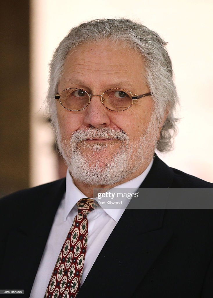 <a gi-track='captionPersonalityLinkClicked' href=/galleries/search?phrase=Dave+Lee+Travis&family=editorial&specificpeople=1624287 ng-click='$event.stopPropagation()'>Dave Lee Travis</a> leaves Southwark Crown Court after being found not guilty of 12 counts of indecent assault, on February 13, 2014 in London, England. <a gi-track='captionPersonalityLinkClicked' href=/galleries/search?phrase=Dave+Lee+Travis&family=editorial&specificpeople=1624287 ng-click='$event.stopPropagation()'>Dave Lee Travis</a>, whose real name is David Patrick Griffin, was charged with 14 counts of indecent assault and one of sexual assault, which allegedly took place between 1977 and 2007 against victims aged between 15 and 29. <a gi-track='captionPersonalityLinkClicked' href=/galleries/search?phrase=Dave+Lee+Travis&family=editorial&specificpeople=1624287 ng-click='$event.stopPropagation()'>Dave Lee Travis</a> entered a not guilty plea to the charges in October last year.