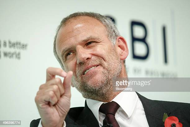 Dave Lewis chief executive officer of Tesco Plc gestures as he speaks during the Confederation of British Industry's annual conference in London UK...