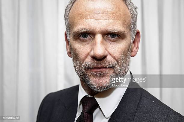 Dave Lewis chief executive officer of Tesco Plc poses for a photograph after speaking during the Confederation of British Industry's annual...