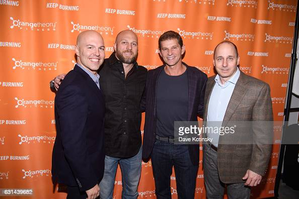 Dave Long Erin Andrews Jerome Kern and Brian Cashman at the Orangetheory Fitness VIP Grand Opening Party at Orangetheory Fitness Astor Place on...