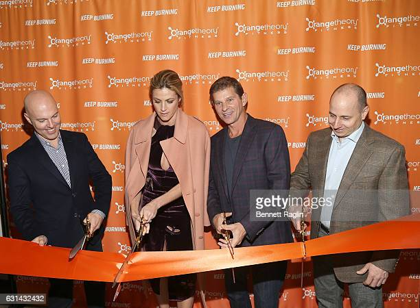 Dave Long Erin Andrews Jerome Kern and Brian Cashman attend the Orangetheory Fitness Grand Opening at Orangetheory Fitness Astor Place on January 10...