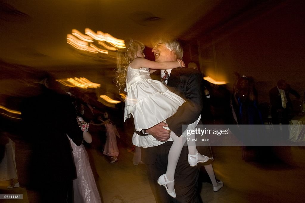 Dave Lorrig dances with his daughter, SarahRose, 7, on May 16, 2008 in Colorado Springs, Colorado. The annual Father-Daughter Purity Ball, founded in 1998 by Randy and Lisa Wilson, focuses on the idea that a trustworthy and nurturing father will influence his daughter to lead a lifestyle of 'integrity and purity.'