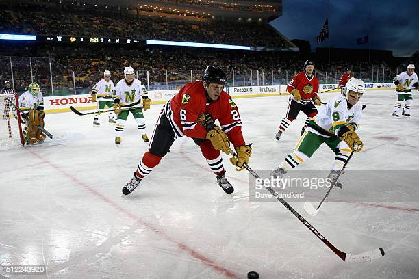 Dave Mackey of the Chicago Blackhawks Alumni and Dennis Maruk of the Minnesota North Stars Alumni skate after the puck during the 2016 Coors Light...