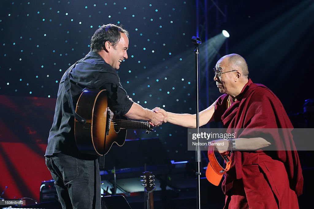 <a gi-track='captionPersonalityLinkClicked' href=/galleries/search?phrase=Dave+Matthews&family=editorial&specificpeople=203324 ng-click='$event.stopPropagation()'>Dave Matthews</a> and His Holiness the Dalai Lama shake hands onstage at the One World Concert at Syracuse University on October 9, 2012 in Syracuse, New York.