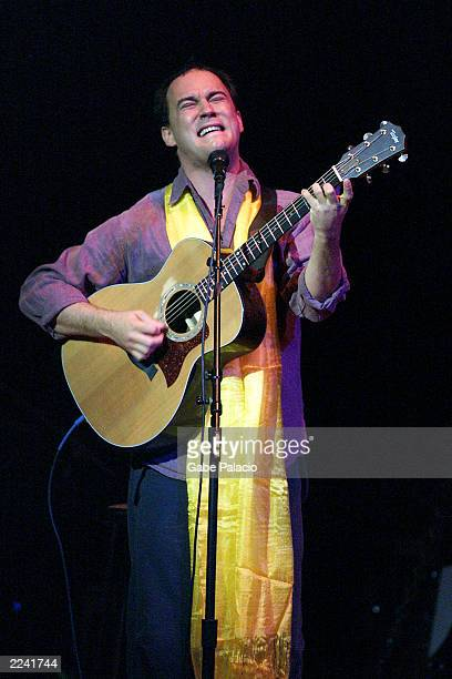 Dave Matthews on stage performing during the Tibet House Benefit Concert 2001 with artistic director Philip Glass Dana Bryant Emmylou Harris Patti...