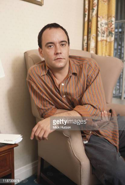 Dave Matthews South Africanborn US musician posing sitting in a chair in London England Great Britain circa 2000
