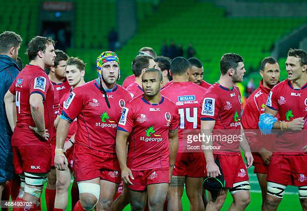 Dave McDuling James OConnor Will Genia Quade Cooper and the Reds leave the field after losing the round eight Super Rugby match between the Rebels...