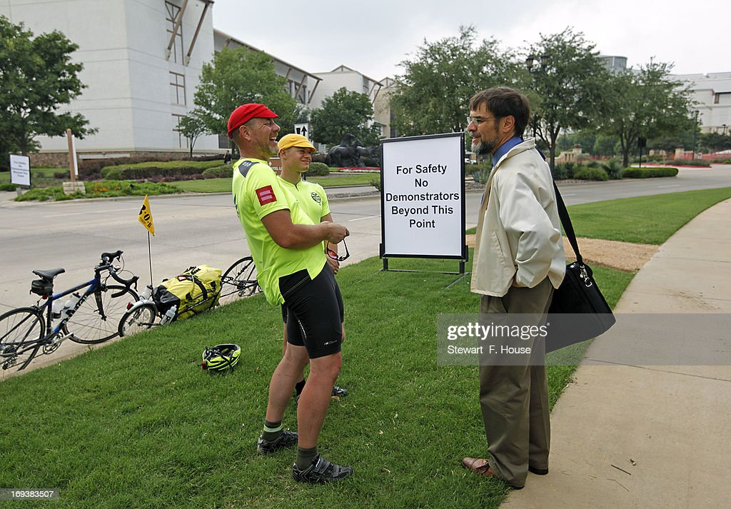 Dave McGrath (L) of Ammon, Idaho and his son Joe, 21, talk with David Ginsborg (R) of San Jose, California, a member of the Boy Scouts Council Board for Silicon Valley, Monterray, and the Bay Area May 23, 2013 in Grapevine, Texas. The McGraths rode their bikes all the way from Idaho to the Gaylord Texan Resort and Convention Center to show their support of the decision by the Boy Scouts of America today that ended its policy of prohibiting openly gay youths from participating in Scout activities.