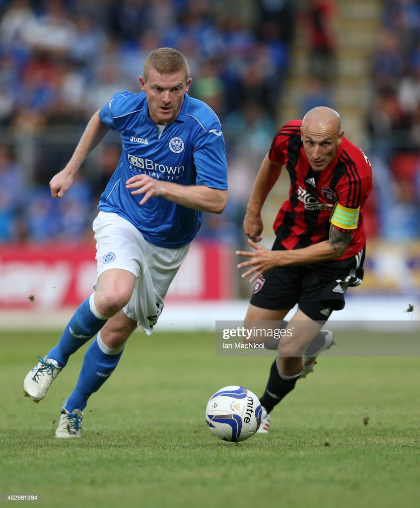 Dave McKay St Johnstone vies with Marek Janecka of Spartak Trnava during the UEFA Europa League Third Qualifying Round, First Leg match between St Johnstone and Spartak Trnava, at McDiarmid Park on July 31, 2014 Perth, Scotland.