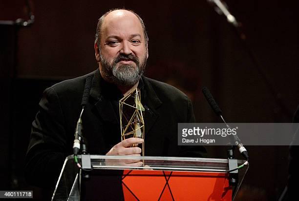 Dave McKean accepts The Raindance Award for Luna at the Moet British Independent Film Awards 2014 at Old Billingsgate Market on December 7 2014 in...
