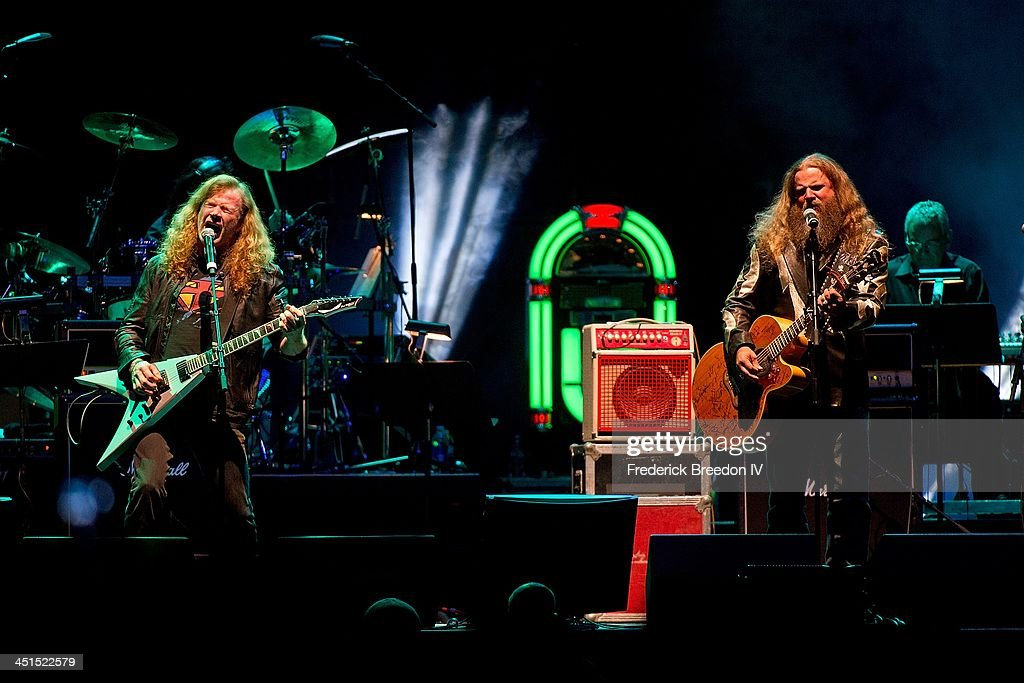 Dave Mustain of the band Megadeth performs with Jamie Johnson during Playin' Possum! The Final No Show Tribute To George Jones at Bridgestone Arena on November 22, 2013 in Nashville, Tennessee.