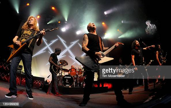 Dave Mustaine and James Hetfield of Metallica perform the finale at Day Four of the bands' 30th Anniversary shows at The Fillmore on December 10 2011...
