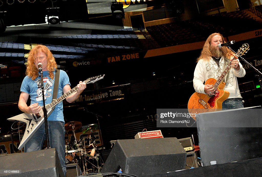 Dave Mustaine of Megadeth and <a gi-track='captionPersonalityLinkClicked' href=/galleries/search?phrase=Jamey+Johnson+-+American+Country+Singer&family=editorial&specificpeople=4264679 ng-click='$event.stopPropagation()'>Jamey Johnson</a> perform during rehearsals of Playin' Possum! The Final No Show Tribute To George Jones at Bridgestone Arena on November 21, 2013 in Nashville, Tennessee.