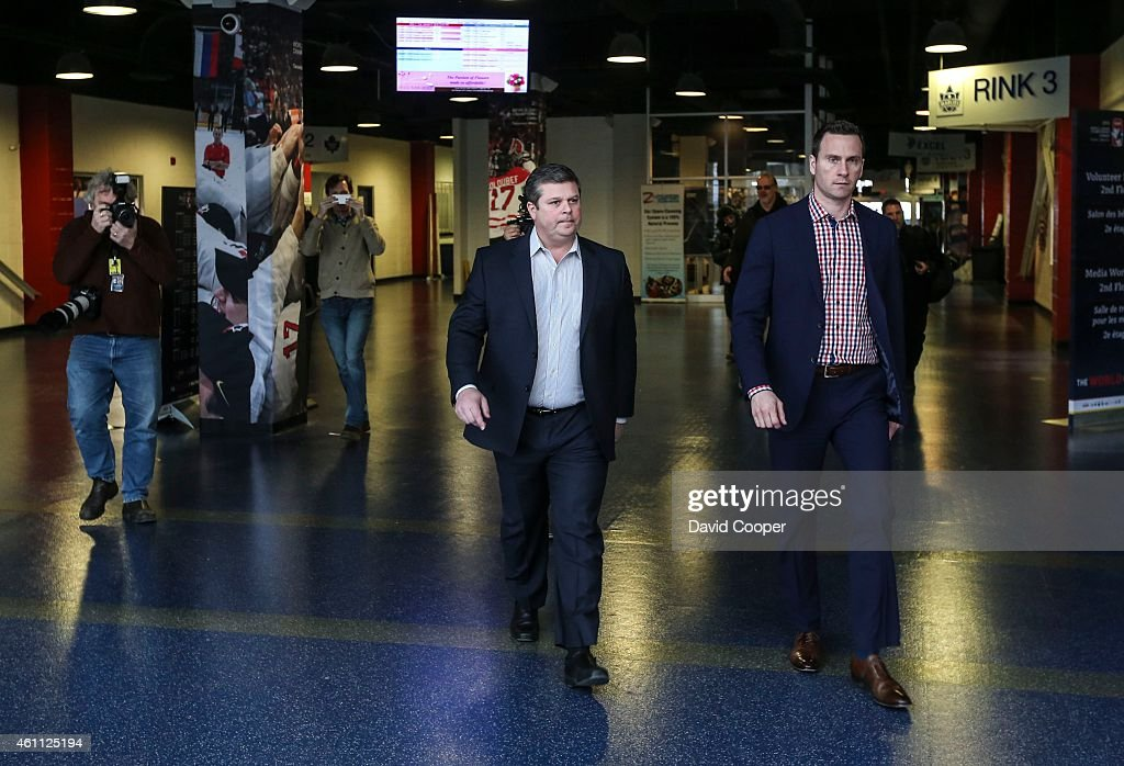 Dave Nonis senior VP and GM of the Leafs walks into the press conference to announce that he fired Randy Carlyle as coach of the Toronto Maple Leafs...