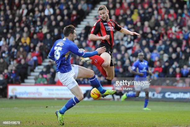 Dave Nugent of Leicester City and Simon Francis of Bournemouth clash in mid air during the Sky Bet Championship match between Bournemouth and...