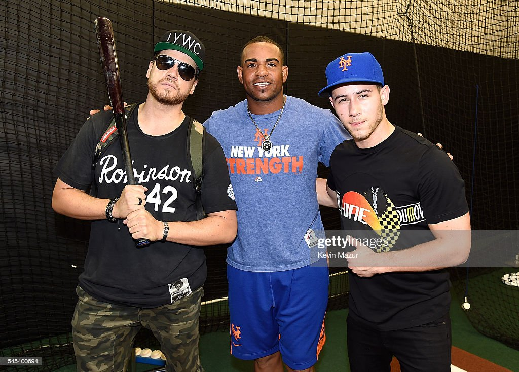 Dave Osokow Yoenis Cespedes and Nick Jonas pose in the batting cages before a New York Mets game at Citi Field on July 7 2016 in New York City
