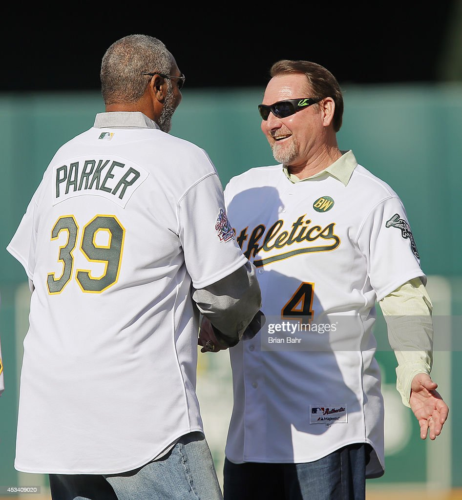 Dave Parker of the 1989 Oakland A's greets Carney Lansford as they celebrate their World Series championship of 25 years ago against the San...