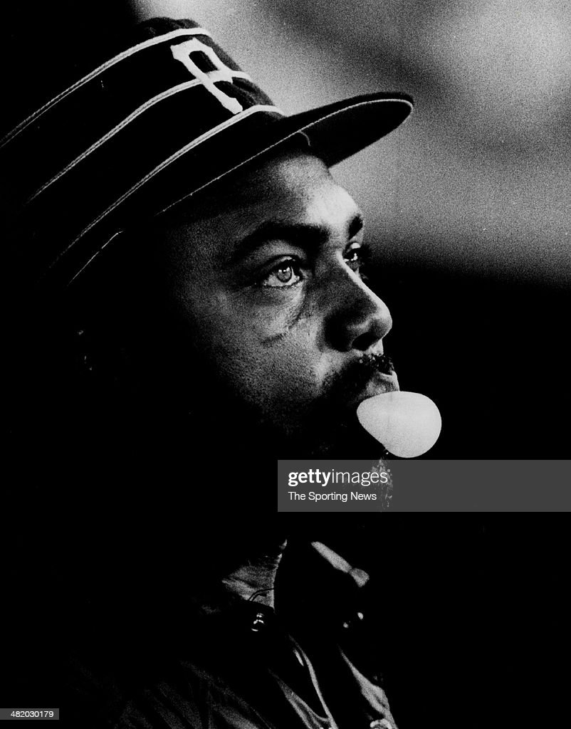 Dave Parker of the Pittsburgh Pirates blows a bubble in the dugout circa 1980s