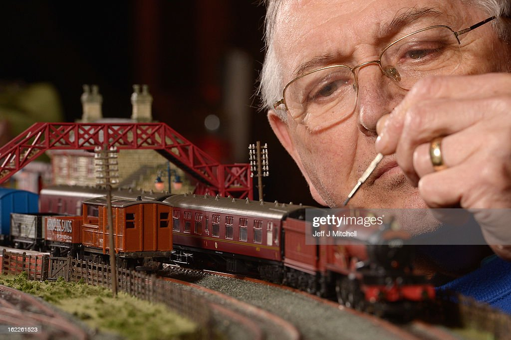 Dave Patterson tinkers with a model train as enthusiasts gather for the Model Rail Scotland exhibition on February 21, 2013 in Glasgow, Scotland. Model railway clubs from all corners of the UK and parts of Europe will be displaying over 50 model railway layouts at this year's event held at The Scottish Exhibition Centre in Glasgow from February 22nd to the 24th.