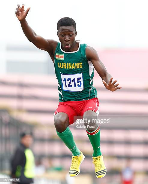 Dave Pika of Suriname competes during Men's Long Jump event as part of the I ODESUR South American Youth Games at Estadio Miguel Grau on September 29...