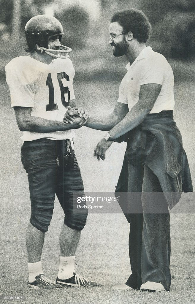 Dave Raimey says goodbye to Billy Cooper before leaving Argo training camp in Aurora yesterday Raimey whose injured knee has not recovered from...