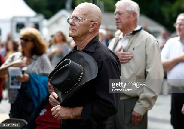 Dave Richards of Charlton places his hat to his heart during the national anthem at the beginning of the official ribbon cutting and dedication of...
