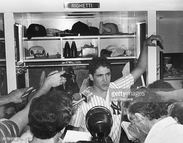 Dave Righetti of the New York Yankees talks to the media inside the players locker room after he pitched a nohitter against the Boston Red Sox at...