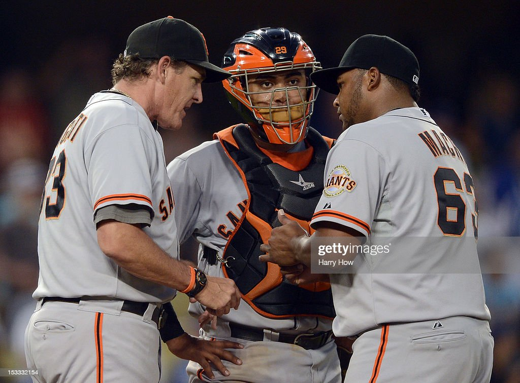 <a gi-track='captionPersonalityLinkClicked' href=/galleries/search?phrase=Dave+Righetti&family=editorial&specificpeople=210835 ng-click='$event.stopPropagation()'>Dave Righetti</a> #73 speaks to Hector Sanchez #29 and Jean Machi #63 after back to back homeruns by the Los Angeles Dodgers during the eighth inning at Dodger Stadium on October 3, 2012 in Los Angeles, California. The Dodgers won 5-1.