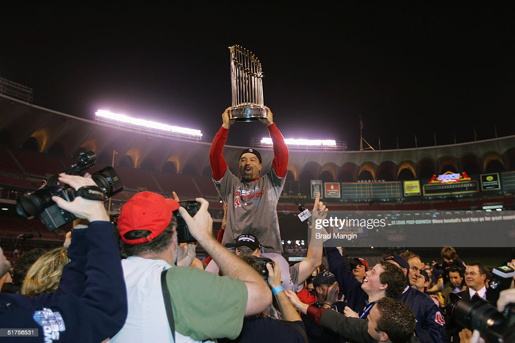 Dave Roberts of the Boston Red Sox celebrates after winning game four of the 2004 World Series against the St Louis Cardinals at Busch Stadium on...