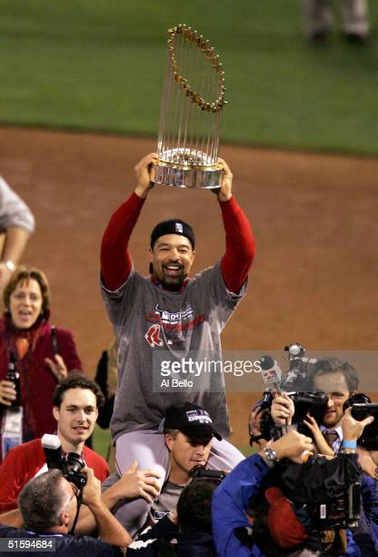 Dave Roberts of the Boston Red Sox celebrates with the trophy after defeating the St Louis Cardinals 30 in game four of the World Series on October...