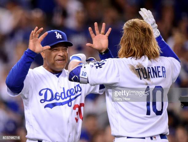 Dave Roberts of the Los Angeles Dodgers celebrates the game winning hit of Justin Turner for a 65 win over the Minnesota Twins during the ninth...