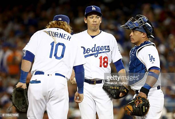 Dave Roberts of the Los Angeles Dodgers comes to the mound to take Kenta Maeda out of the game in the fourth inning against the Chicago Cubs in game...