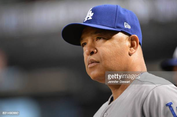 Dave Roberts of the Los Angeles Dodgers looks on in the MLB game against the Arizona Diamondbacks at Chase Field on August 10 2017 in Phoenix Arizona
