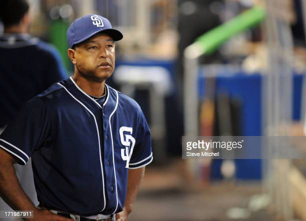 Dave Roberts of the San Diego Padres looks on from the dugout during the sixth inning against the Miami Marlins at Marlins Park on June 30 2013 in...