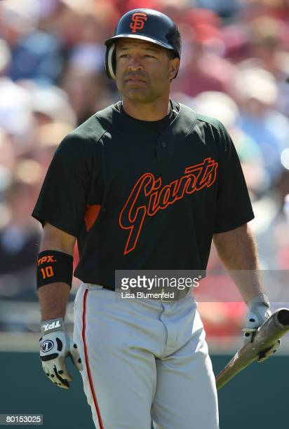 Dave Roberts of the San Francisco Giants wakls back to the dugout after striking out during a Spring Training game against the Los Angeles Angels of...