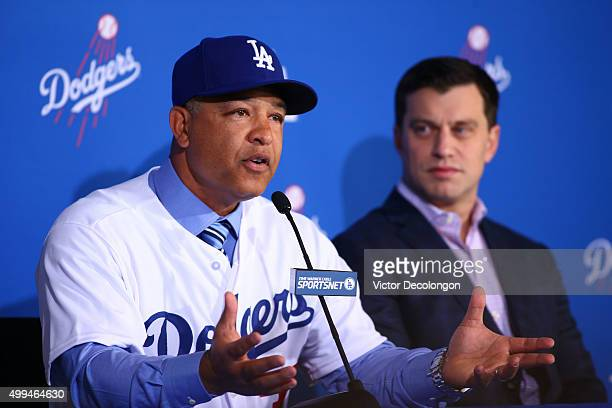 Dave Roberts speaks as Andrew Friedman Dodgers President of Baseball Operations looks on during a press conference to introduce Roberts as the new...