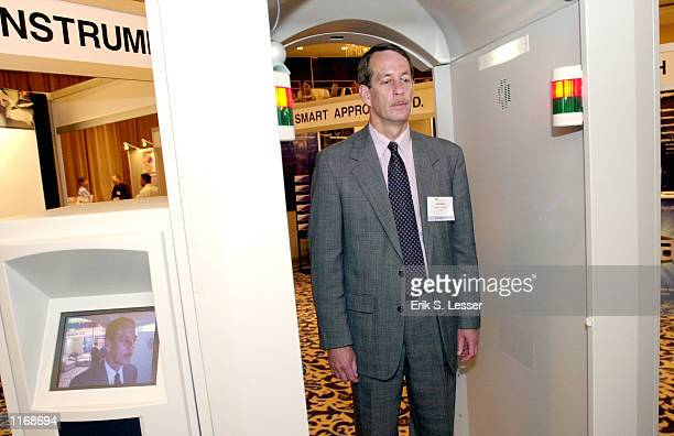 Dave Rutter of Ion Track Instruments is scanned for explosives while demonstrating his company's sniffer device October 17 2001 at the IATA's AVSEC...