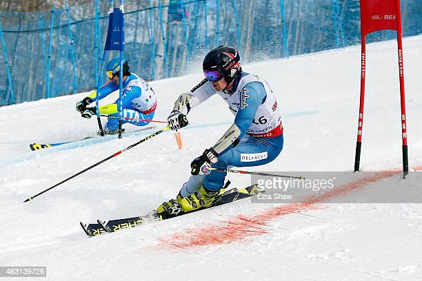 Dave Ryding of Great Britain races against Giovanni Borsotti of Italy during the Nations Team Event at Golden Peak Stadium on Day 9 of the 2015 FIS...