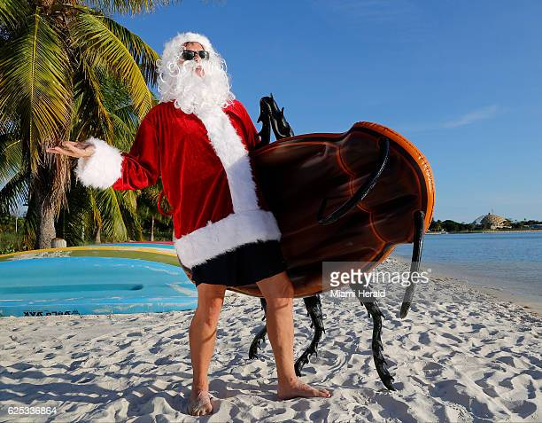 Dave 'Santa Claus' Barry finds the perfect beach spot for his 'Giant Cockroach Pool Float' to 'chillax' prior to the hectic Christmas 'bad gifts'...