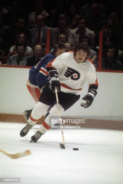 Dave Schultz of the Philadelphia Flyers skates with the puck during an NHL game against the New York Rangers circa 1972 at the Spectrum in...